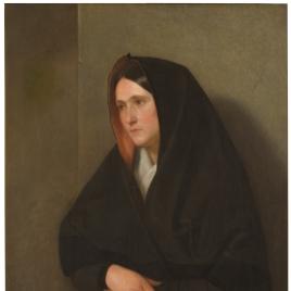 Mujer manchega rezando