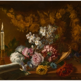 Flores con una vela y un papel
