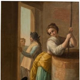 Mujer sacando agua de un pozo
