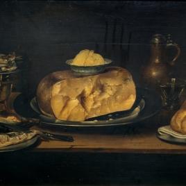 Bodegón: mesa con vajilla, queso, salchichón y pescados