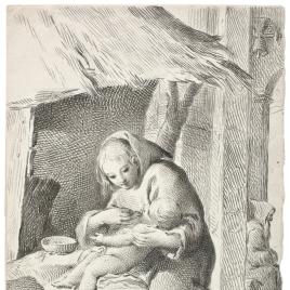 Mujer dando de comer a un niño