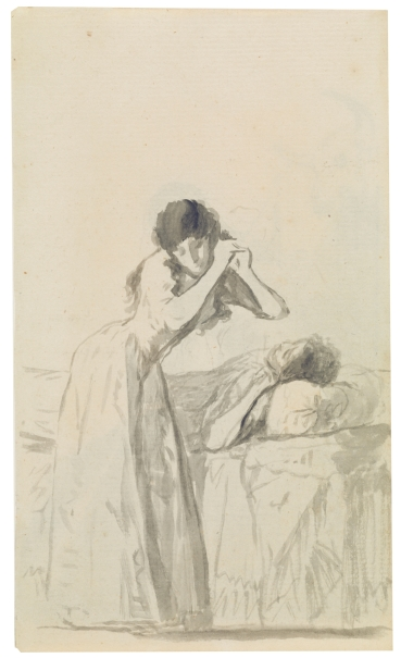 Young woman stroking her hair