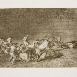 Two groups of picadors knocked over one after another by the bull