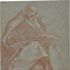 Figura de obispo sentado con un libro