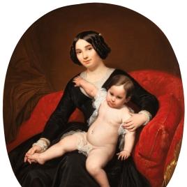 Dama con un niño en brazos